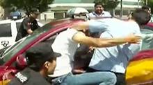 北京:歹徒抢劫出租车 民警布网火速擒匪